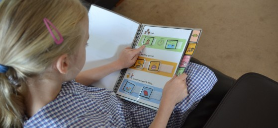 Image of a child using a communication aid funded by Kids Chat - Non-electronic Communication Aid (NECAS) for Children
