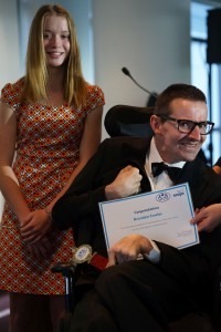 Paralympian Isis Holt presents Sportsperson of the Year award to Brendan Fowler.