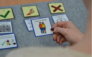 A hand selecting a card on a mat
