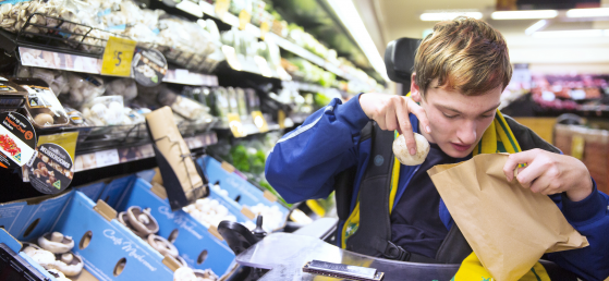 Cameron, a Scope customer is supported to shop for food at the supermarket